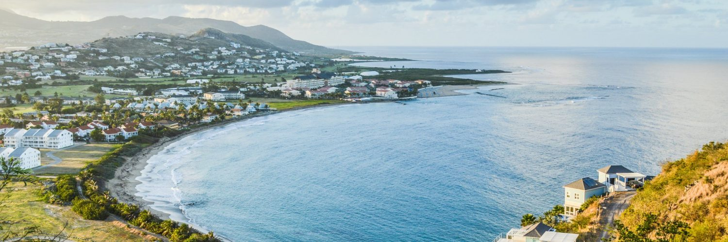 Looking at a touristic bay from up above on the mountain in St-Kitts-Nevis.